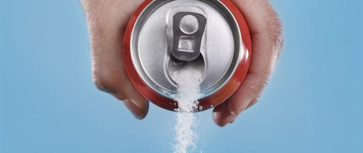 Sugar pouring from a can